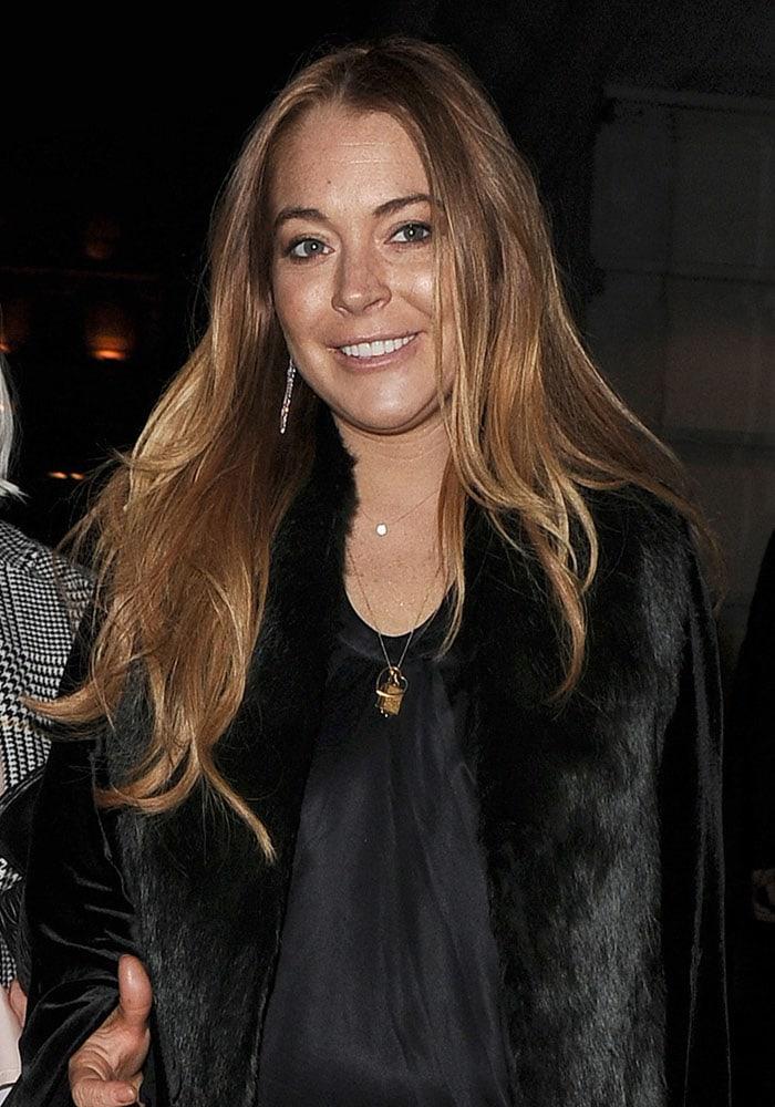 Lindsay Lohan in an oversized velvet-and-fur coat
