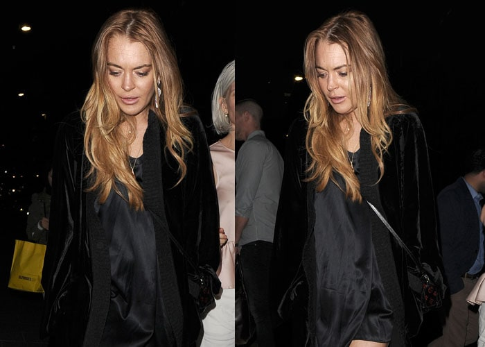 Lindsay Lohan stepped out in a short black dress