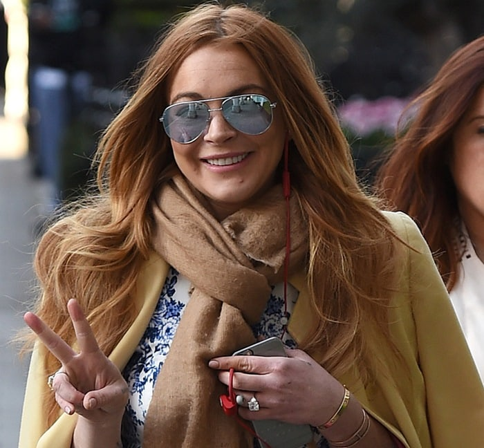 Lindsay Lohan completed the outfit with a cashmere scarf