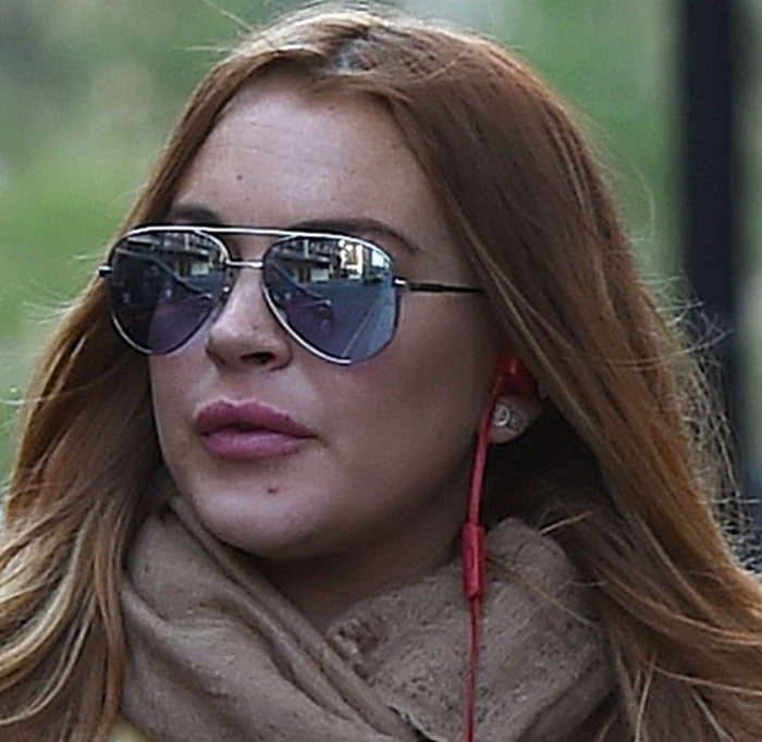 Lindsay Lohan with swollen lips and a bad complexion