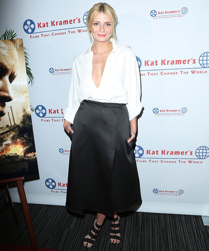 Mischa Barton wore an edgy black skirt featuring a thigh-high slit and a pair of strappy heels