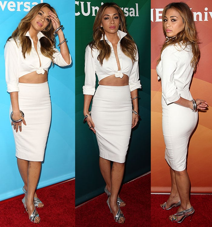 Nicole Scherzinger flaunted her legs in a Sergio Hudson knotted cropped shirt and pencil skirt