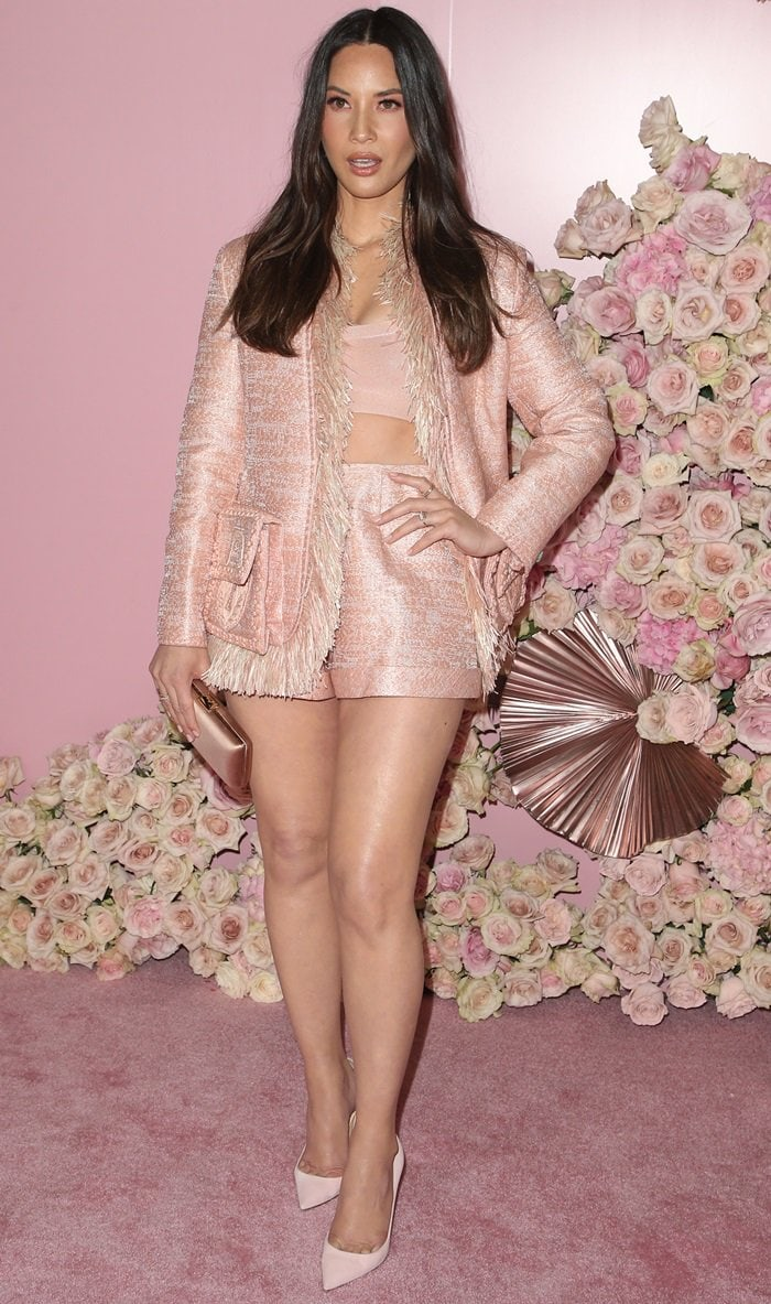 Olivia Munn flashed her legs at the launch of Patrick Ta's Beauty Collection at Goya Studios in Los Angeles on April 4, 2019