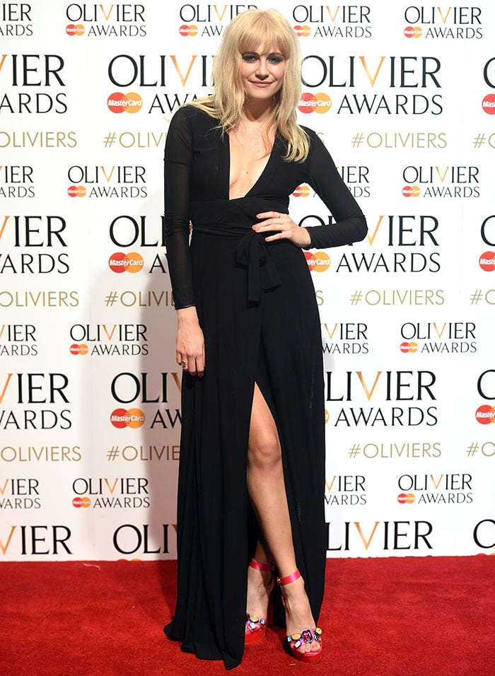Pixie Lott flashed her legs in a racy floor-length black dress by Issa
