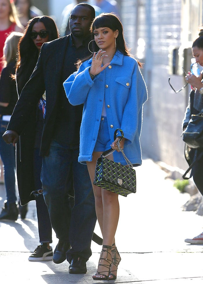 Rihanna flashed her enviable pins in an oversized blue coat by Moschino