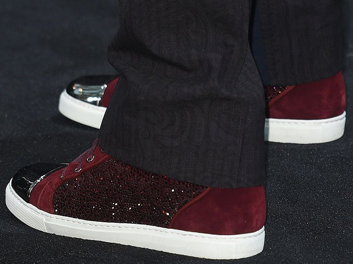 Closeup of Robert Downey Jr.'s burgundy suede sneakers with crystal-studded sides and silver toe caps