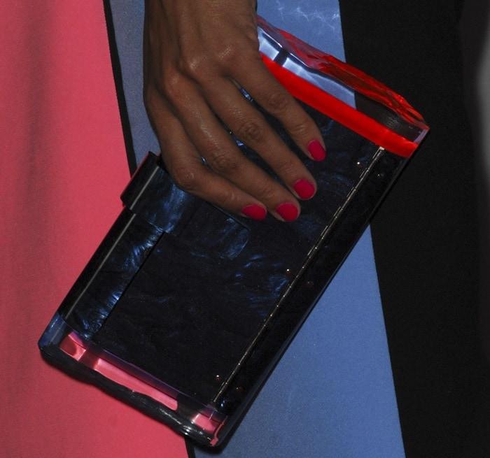 Rosario Dawson toted a clutch bag