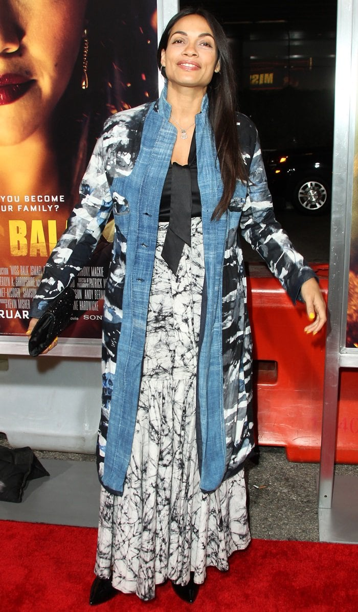 Rosario Dawson's patterned denim duster over a paint-streaked dress and black patent leather shoes