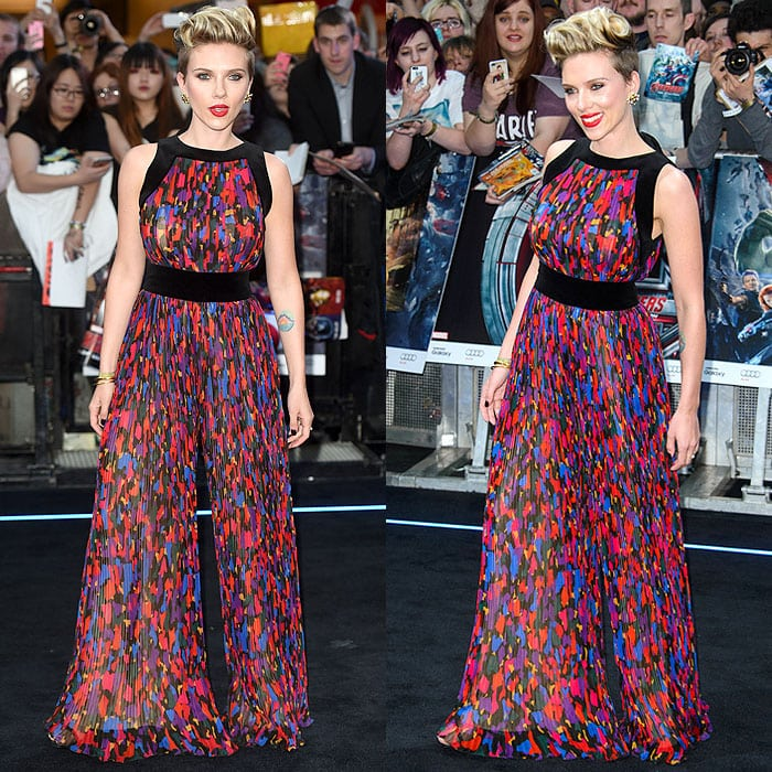 Scarlett Johansson wearing a colorful camo-print pleated jumpsuit from the Balmain Fall 2015 collection
