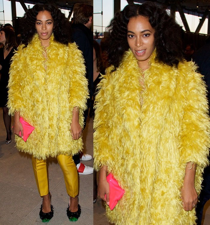 Solange Knowles covered up her slender figure in a huge yellow fur coat paired with mustard cropped satin trousers by Katie Ermilio and a bright pink clutch by Anya Hindmarch