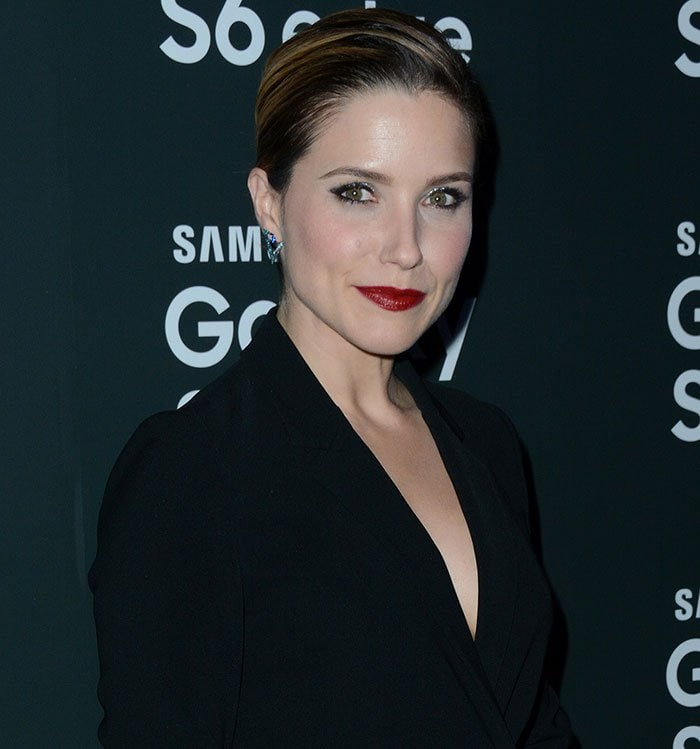 Sophia Bush's slicked-back pixie hairstyle and red lipstick