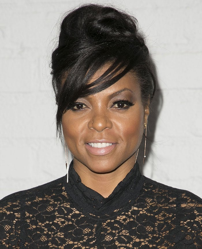 Taraji P. Henson styled her dark tresses up into a bun with a side-swept fringe