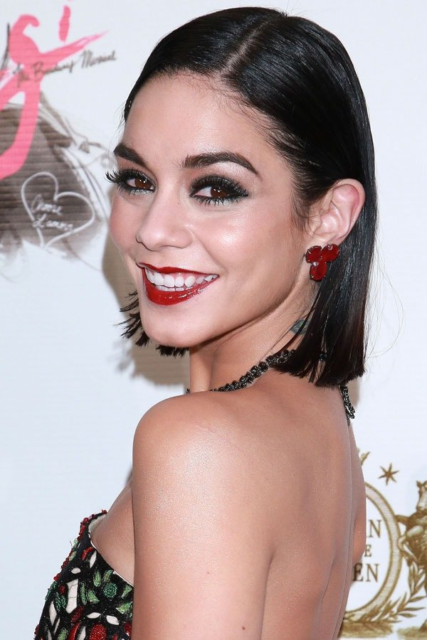 Vanessa Hudgens matches her blood-red lips to her ruby red earrings