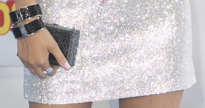 Victoria Justice's clutch and jewelry by Swarovski