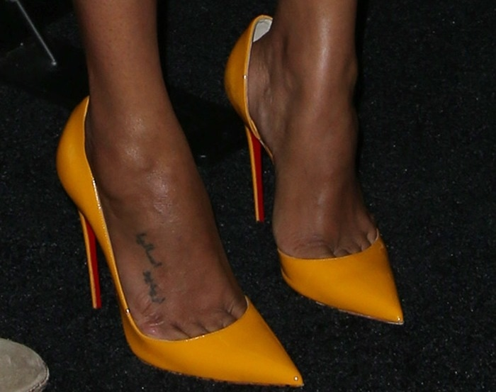 "Zoe Saldana in yellow patent leather ""Iriza"" pumps from Christian Louboutin"