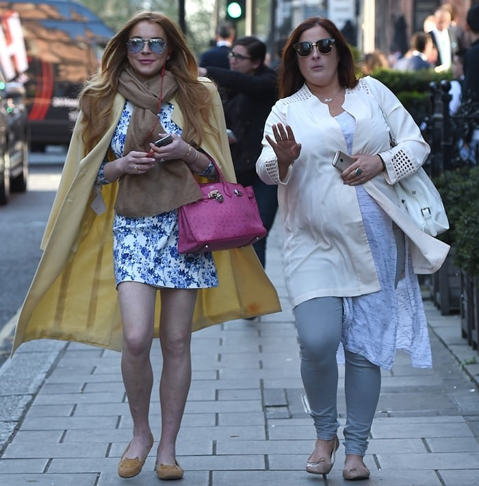 Lindsay Lohan leaving Scott's restaurant in Mayfair with a female companion in London, England, on April 23, 2015