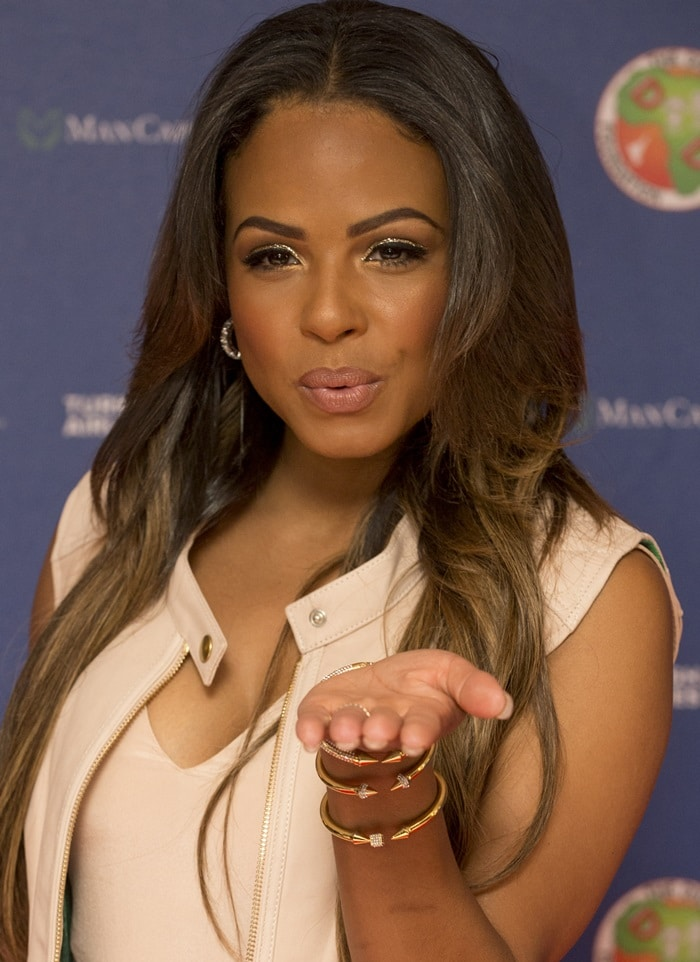 Christina Milian blows a kiss at The Dorchester Hotel for The Didier Drogba Foundation Charity Ball on April 19, 2015, in London, England