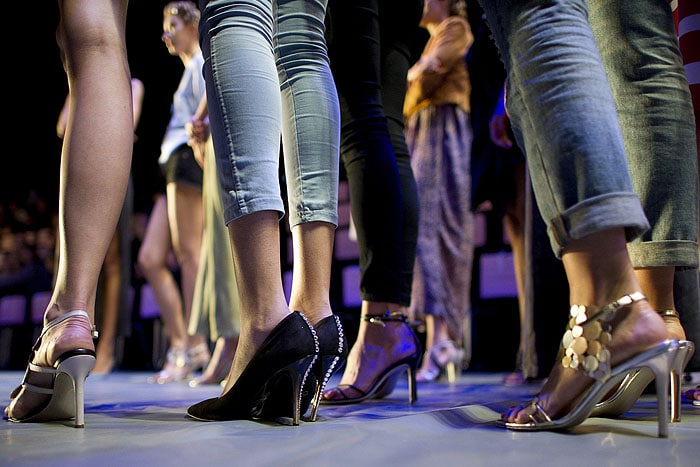 Models wearing shoes of varying heel heights at the HOEGL designed by Guido Maria Kretschmer fashion presentation