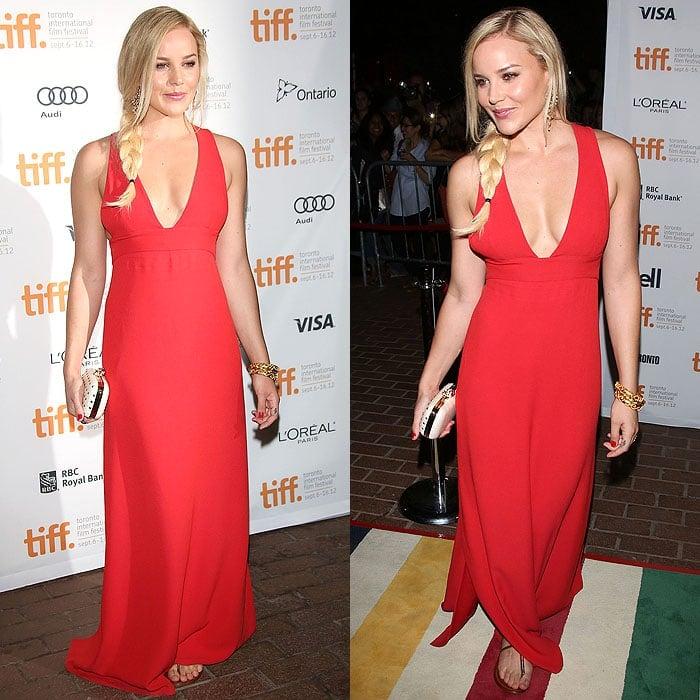"Abbie Cornish gave her red Giulietta Spring 2012 dress a splash of laidback Australian vibe with Aldo ""Kaprisha"" flats"
