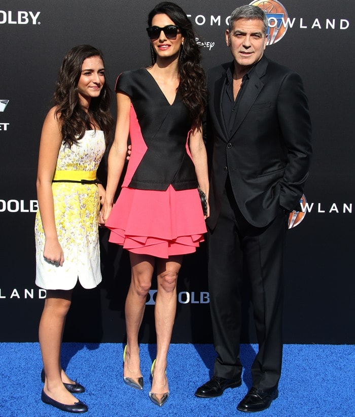 Mia Alamuddin, Amal Clooney and George Clooney pose for photos on the blue carpet