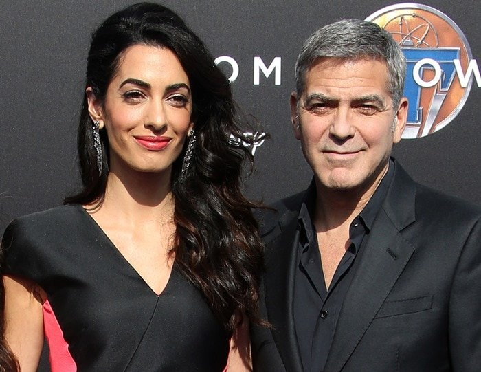 """Amal Clooney wears her hair down at the premiere of """"Tomorrowland"""" as she poses with husband George Clooney"""