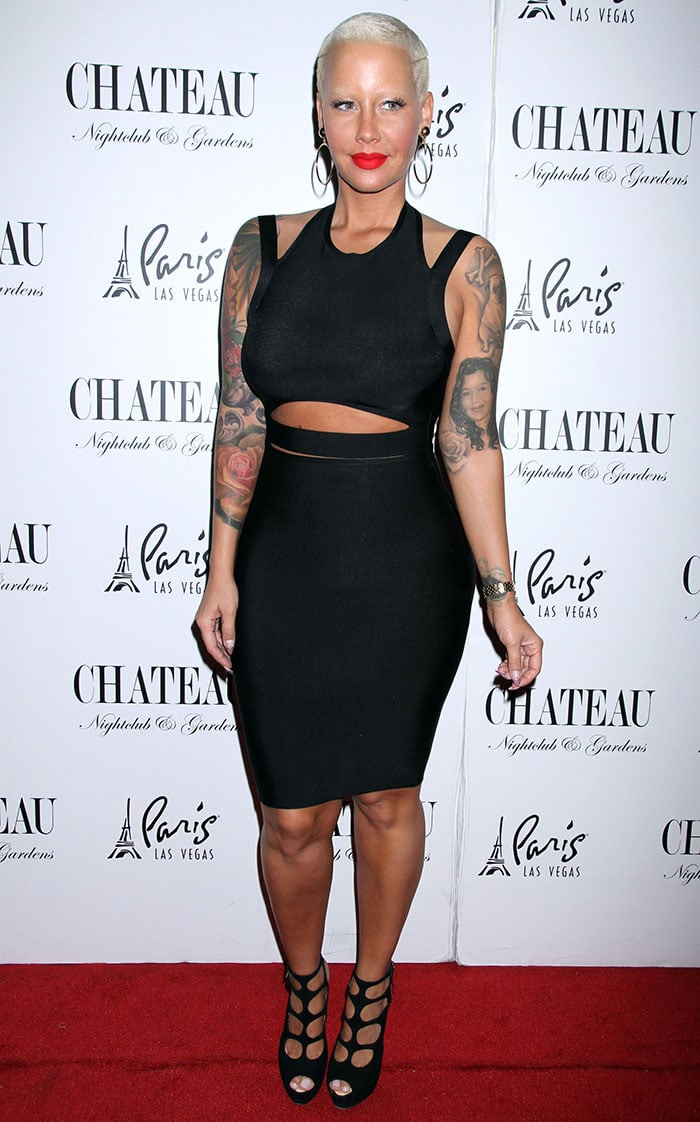 Amber Rose flashes her legs in a curve-hugging LBD featuring cutout details