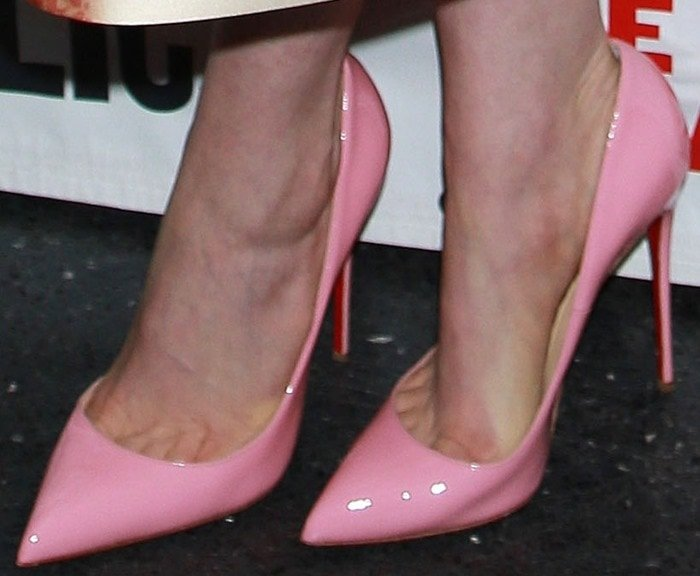 Anne Hathaway's bubblegum pink pointy-toe Christian Louboutin pumps