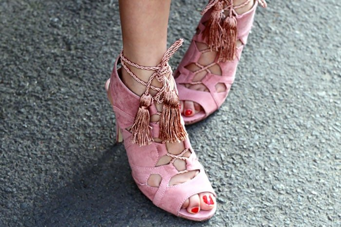 Anoushka's pink lace-up sandals with tassel tie ends