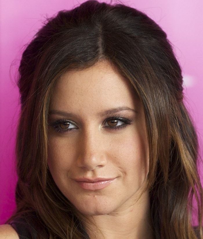 Ashley Tisdale poses for photographs at an autograph signing session for Sharpay's Fabulous Adventure at El Corte Inglés Castellana in Madrid, Spain on May 23, 2011