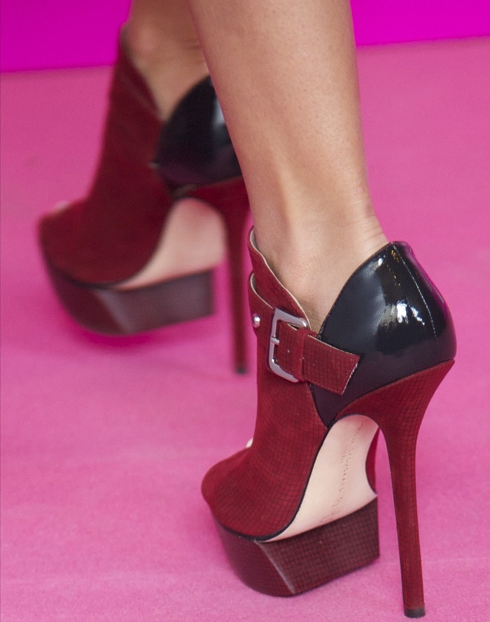 Close-up of Ashley Tisdale's red open toe Camilla Skovgaard booties