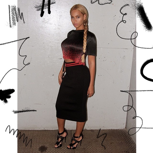 Beyonce sported a micro-pleated spray paint crop top from Alexander Wang paired with a black pencil skirt with a red waistband