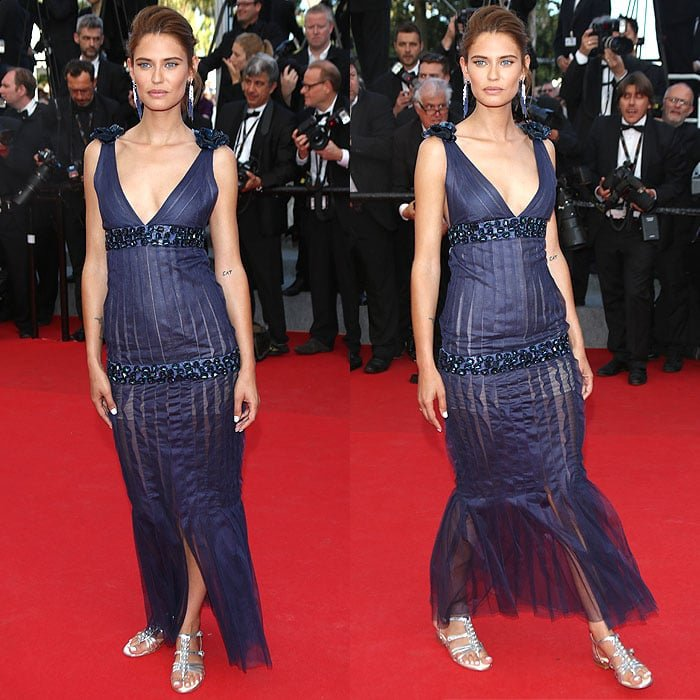 Bianca Balti showed off some of her professional poses in a navy Chanel spring 2012 Couture jewel-embellished dress and silver gladiator sandals