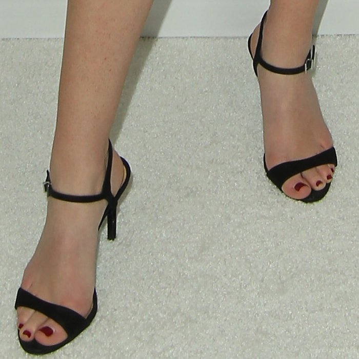 Britt Robertson's sexy feet in black ankle-strap stiletto sandals