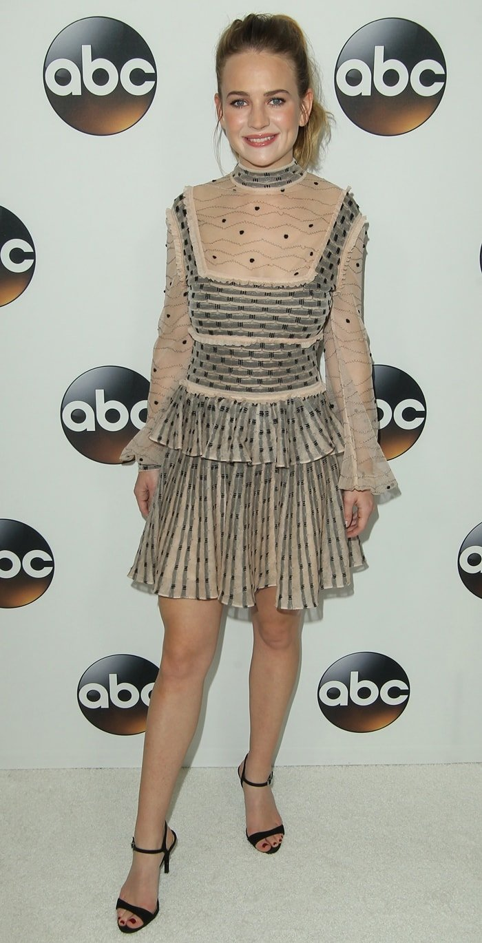 Britt Robertson flaunted her hot legs in a sheer lace dress