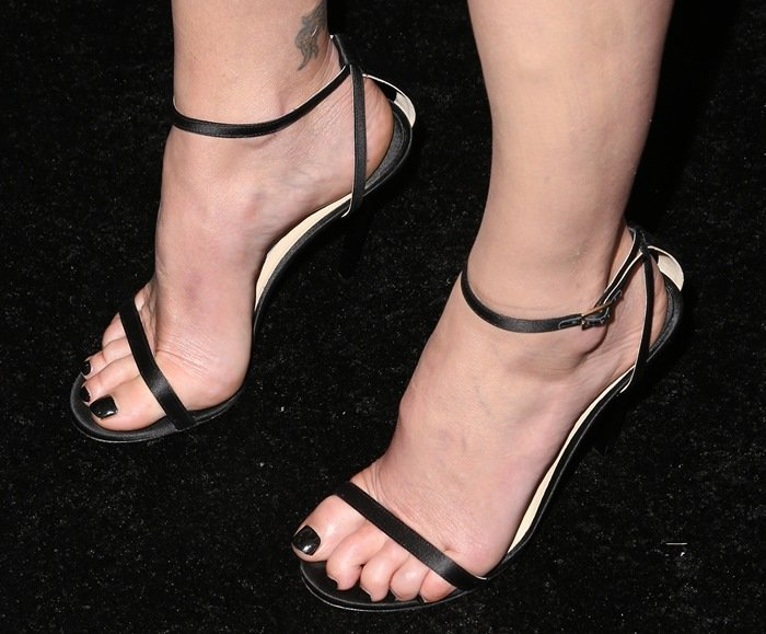 Charlize Theron showing off her feet in a stunning pair of ankle-strap sandals