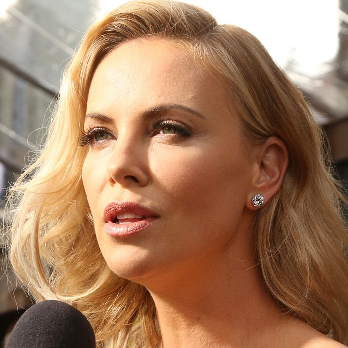 Charlize Theron giving an interview at the premiere of her new movie 'Mad Max: Fury Road' held at TCL Chinese Theatre