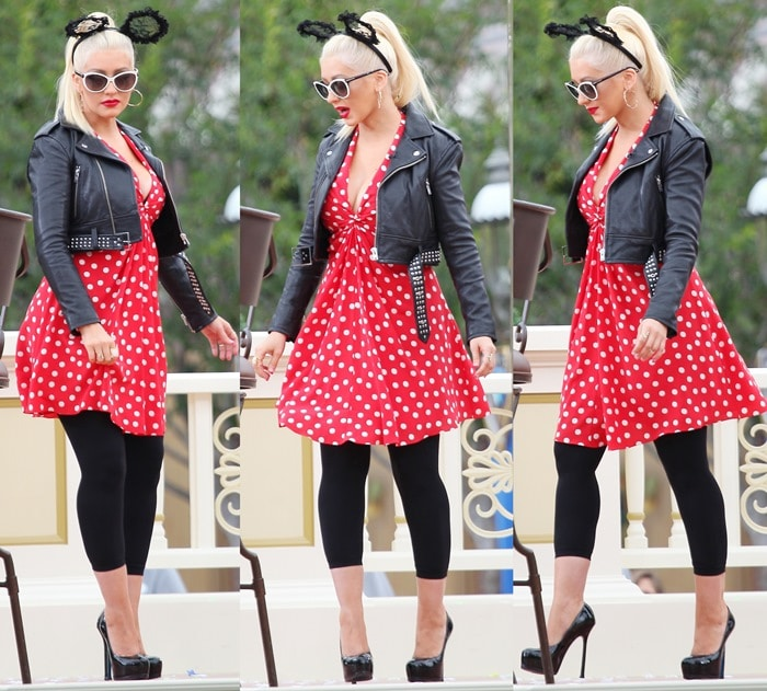 Christina Aguilera flashed her legs in a red polka-dot print dress and a cropped leather jacket
