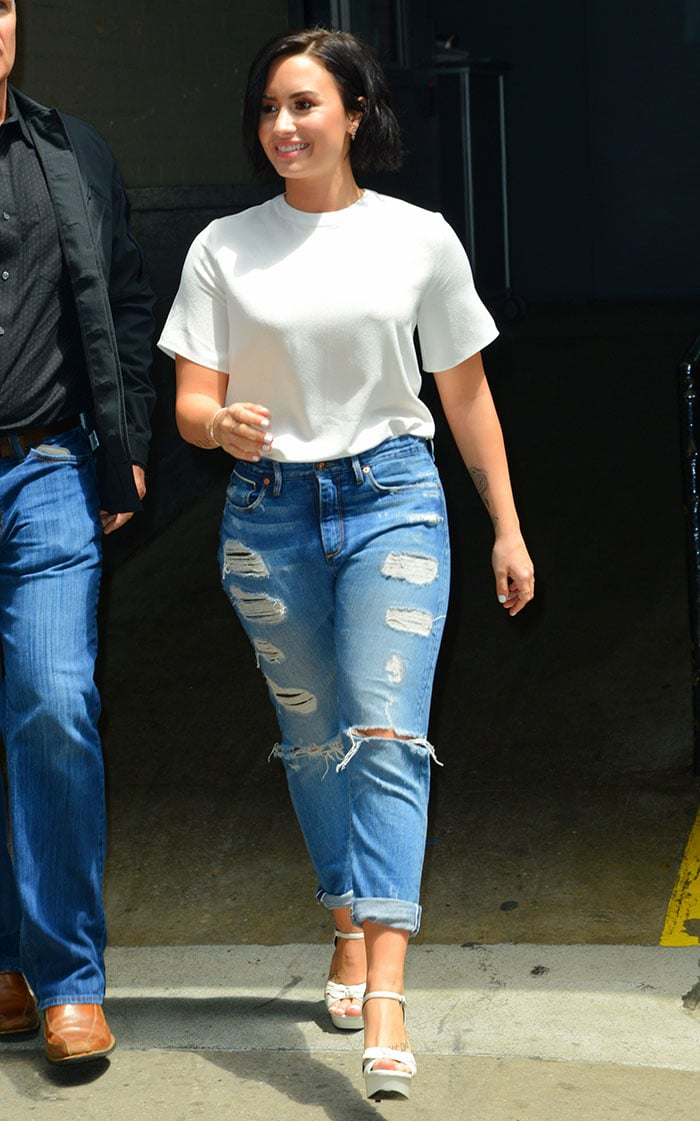 Demi Lovato wore a plain white top tucked in a pair of cuffed ripped jeans