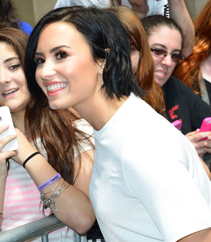 Demi Lovato's raven locks were swept to one side