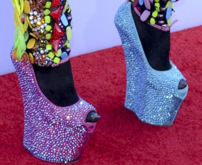 Dencia in super sparkly heel-less wedges