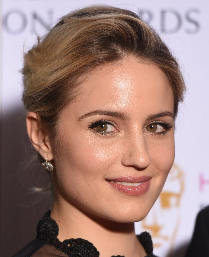 Dianna Agron shows off her sexy lips and earrings
