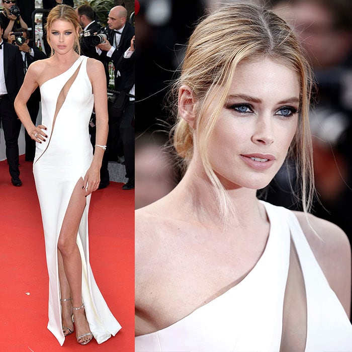 Doutzen Kroes flashes her legs at the opening ceremony of the 68th annual Cannes Film Festival