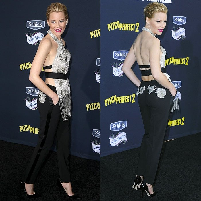 Elizabeth Banks in a Marchesa Fall 2015 beaded and fringed halter top and tuxedo trousers