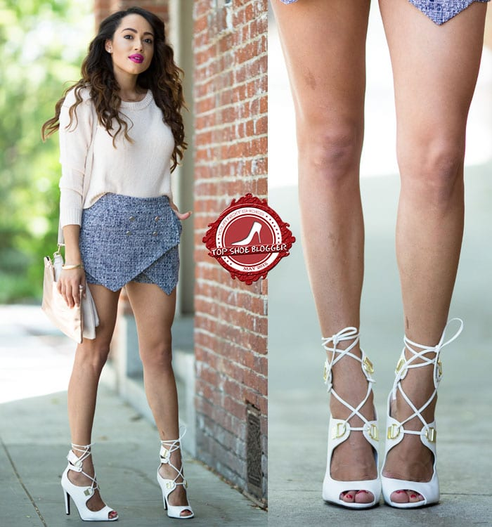 Elizabeth flaunts her legs in a knit top, skorts, and white strappy lace-up sandals