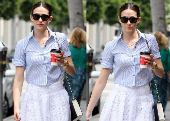 Emmy Rossum wears a pinstriped shirt with rolled up sleeves