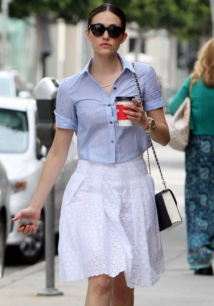 Emmy Rossum strolled through the streets of Beverly Hills with her coffee in hand