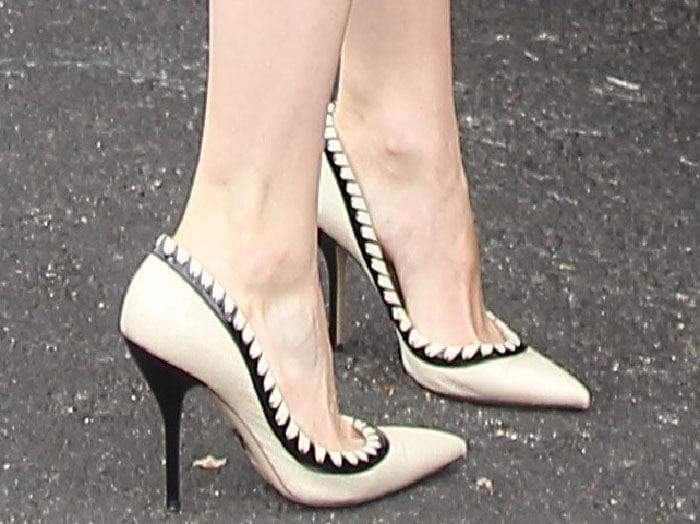 Emmy Rossum's feet in Paul Andrew beige raffia pumps