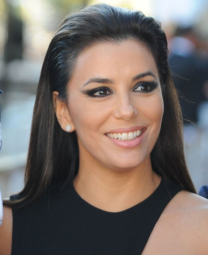 Eva Longoria wore her dark hair in a slick brushed-back style