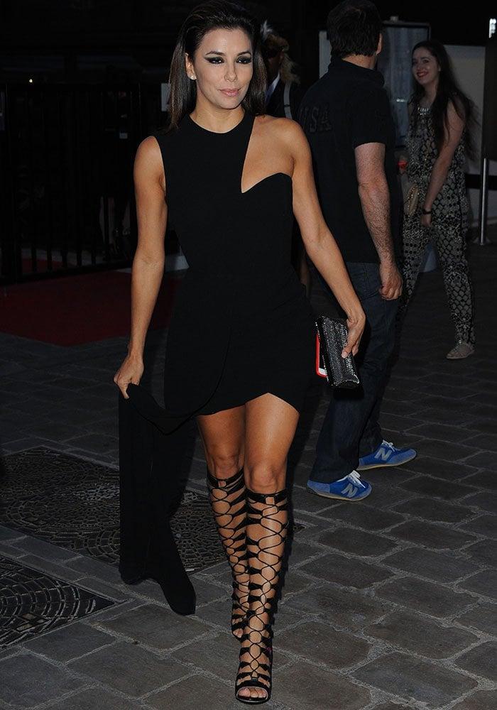 Eva Longoria rocked racy knee-high sandal boots by Oscar Tiye