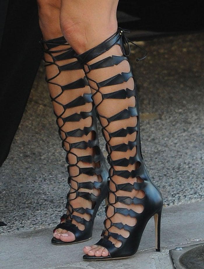 Eva Longoria wearing Oscar Tiye sandal boots